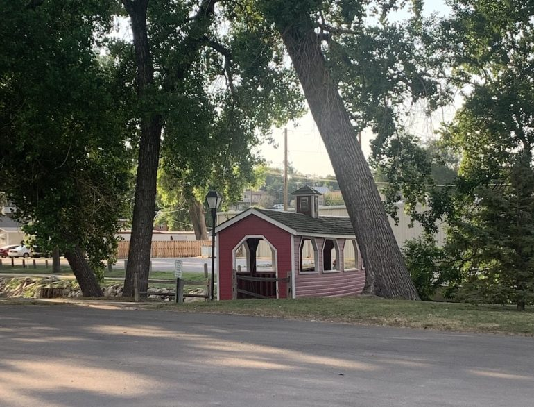 Cute covered bridge across the small canal to the street