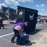 The FedEx pit box getting set up.