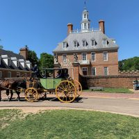 The Governor's Palace, and the carriage that will give you a ride around Colonial Williamsburg.