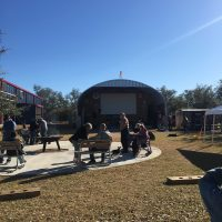 A fire pit, benches, and the stage within earshot