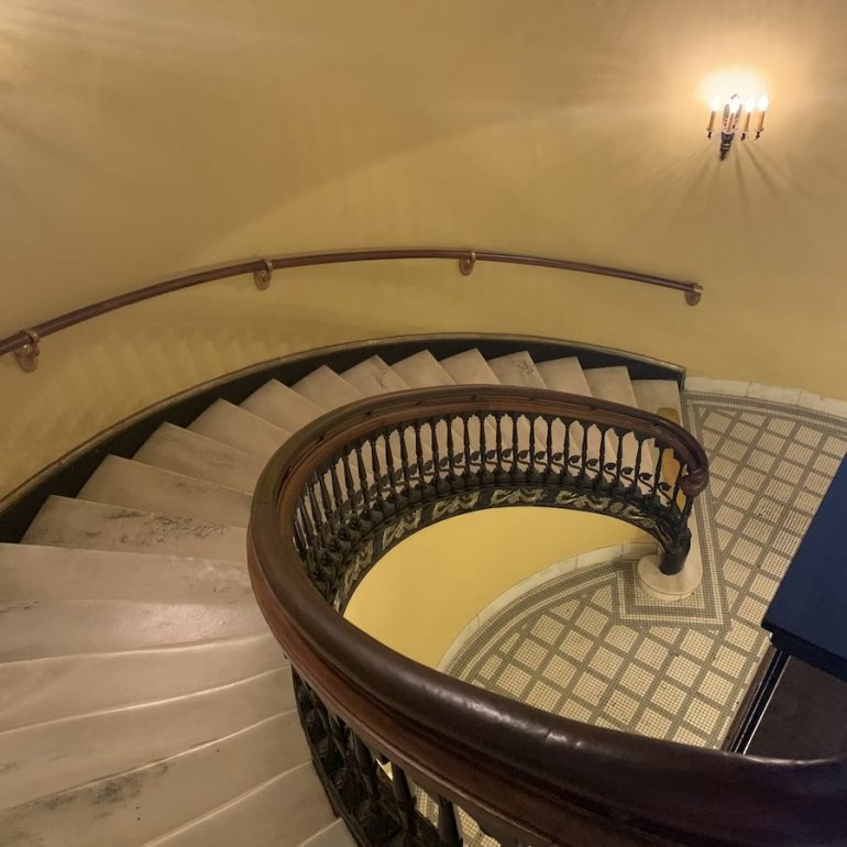 Elegant marble staircase to the basement.