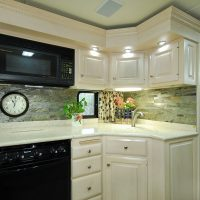 The kitchen area of the Motorhome. We recently replaced the old mirrored backsplash with this updated stone.